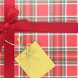 Stock Photo: Top of present box with red ribbon