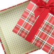 Stock Photo: Top of empty present box with red ribbon