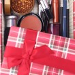 Present box with cosmetics inside — Stock Photo