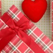 Present box with red heart inside — Stock Photo