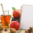 Autumn background basket with apples and notebook — Stock Photo