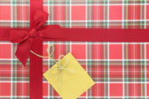 Top of present box with red ribbon — Stockfoto