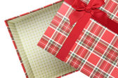 Top of empty present box with red ribbon — Stockfoto