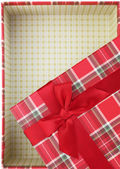 Top of empty present box with red ribbon — Stok fotoğraf