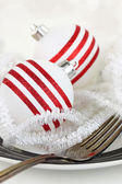 Christmas table setting with ornament on a plate — Stock Photo