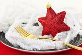 Christmas table setting with ornaments on a plate — Stock Photo