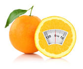 Weight scale on an orange, diet concept — Stock Photo