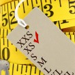 Measuring tape closeup with xs size tag — Stock Photo #35929177