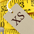 Measuring tape closeup with size tag — Stock Photo #35929237