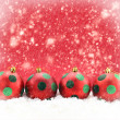Red Christmas balls on snowing background — Photo
