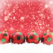 Foto Stock: Red Christmas balls on snowing background