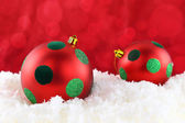 Red Christmas balls on the snow — Stock Photo