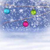 Christmas balls hanging on snowy branch — Stock Photo