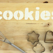 "Stencil word ""cookies"" made with flour on wooden table — Foto de Stock"