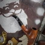 Santa made of snow spray smoking pipe on wooden desk — Stock Photo #36707015