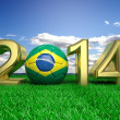 Stock Photo: Gold 2014 with Brazilisoccer ball on grass and blue sky