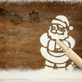 Concept for baking with Santa Claus and snow made of flour — Stock Photo