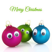 Cute Christmas balls with eyes isolated on white — Stock Photo