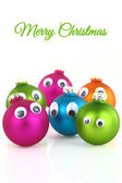 Colorful cute Christmas balls with eyes isolated on white — Stock Photo