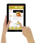 Hands holding tablet with recipe website template isolated — Stock Photo
