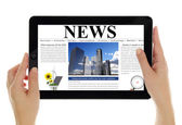 Hands holding tablet with digital news, isolated on white — Stock Photo