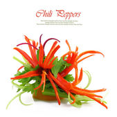 Decoration flowers from red chilly peppers isolated on white — Stock Photo