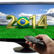 2014 and soccer ball with Brazil flag on tv — Stock Photo