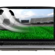 Soccer ball in motion flying off laptop screen isolated — Stock Photo