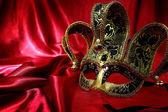 Vintage venetian carnival mask on velvet background — Stock Photo
