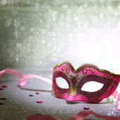 Pink carnival mask with glittering background — Stock Photo