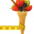 Fresh fruits on ice cream cone with tape measure — Stock Photo #41537283