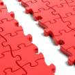 Jigsaw puzzle, red blank template with one row missing — Stock Photo