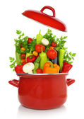 Colorful vegetables in a red cooking pot isolated on white background — Stock Photo