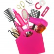 Stock Photo: Various hairstyling equipment in shopping bag isolated on white
