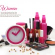 Pink clock with various cosmetics isolated on white background — Foto Stock