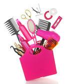 Various hairstyling equipment in shopping bag isolated on white — Stock Photo