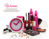 Pink clock with various cosmetics isolated on white background  — Stockfoto