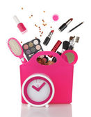 Pink shopping bag and clock with various cosmetics isolated  — Stockfoto