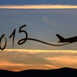 New year 2015 drawing by airplane on the air at sunset — Stock Photo #42400143
