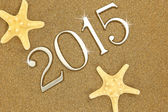 Year 2015 numbers on the sand — Stock Photo