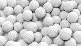 Many golf balls together closeup isolated on white  — ストック写真