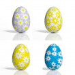 Four colored eggs with flowers isolated on white — ストック写真
