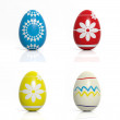 Four eggs with flowers and geometric shapes isolated — ストック写真