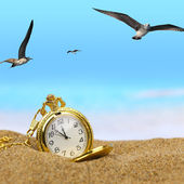Pocket clock on the beach — Stock Photo