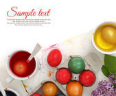 Colored Easter eggs and liquid color dyes on white background — Photo