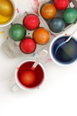 Colored Easter eggs and liquid color dyes on white background — ストック写真
