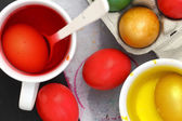 Colored Easter eggs and liquid color dyes — Стоковое фото
