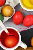 Colored Easter eggs and liquid color dyes — ストック写真