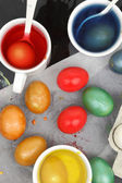 Colored Easter eggs and liquid color dyes — Zdjęcie stockowe