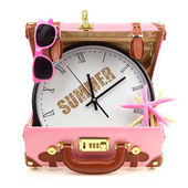 Pink travel suitcase with clock, sunglasses and starfish isolated — Stockfoto